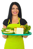 Happy market worker serving cheese Stock Images