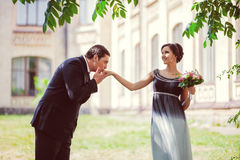 Happy marriage concept. Groom kissing brides hand Stock Image