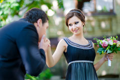 Happy marriage concept. Groom kissing brides hand Stock Photos