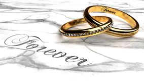 Happy marriage, love forever, together eternally. Symbolized by two expensive, joined together, inseparable wedding rings with engraved word `forever` on a Royalty Free Stock Photos