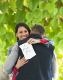 Happy Marriage Proposal. Outdoor photo of young couple embracing after marriage proposal royalty free stock image