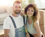 Happy married couple on the background of a new apartment. Married couple on the background of a new apartment. Planning the future Royalty Free Stock Photos