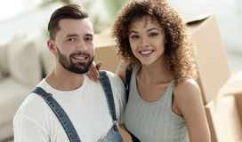 Happy married couple on the background of a new apartment. Married couple on the background of a new apartment. Planning the future Stock Photography