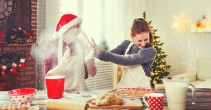 Happy married couple baking christmas cookies royalty free stock image