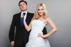 Happy married couple bride groom on gray background Stock Photos