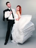 Happy married couple bride groom on gray background Stock Photography