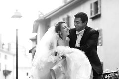 Happy married couple bride and groom running & laughing in old f Royalty Free Stock Photography