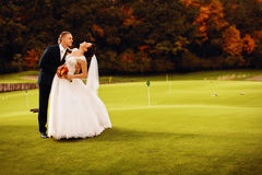 Happy married couple on field Stock Photos