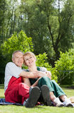 Happy married couple in garden Stock Photos