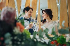 Happy married couple is laughing on the wedding. Emotional beautiful newlywed couple smiling at wedding reception Stock Photography