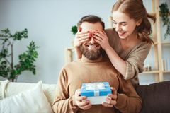 Happy married couple man and woman give a gift for holiday royalty free stock photo