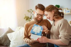 Happy married couple man and woman give a gift for holiday royalty free stock photos