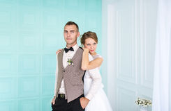 Happy married couple standing in white bedroom Royalty Free Stock Photography