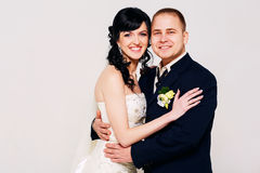 Happy married couple in studio Stock Photos