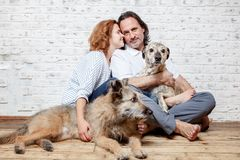 A happy married couple with their dogs, a seed portrait, love, c. Are, friendship, devotion Stock Photos