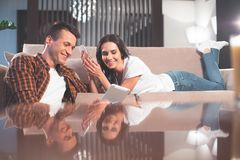 Free Happy Married Couple Using Gadgets At Home Royalty Free Stock Images - 119185659