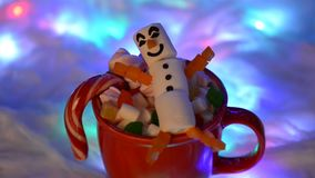 The happy marshmallow snowman in mag, snow decoration stock video