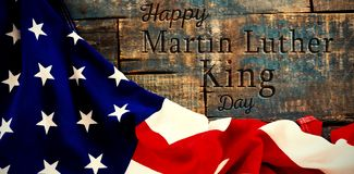 Composite image of happy martin luther king day. Happy Martin Luther King day against american flag on a wooden table stock illustration