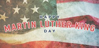 Composite image of happy martin luther king day. Happy Martin Luther King day against full frame of wrinkled american flag stock photo