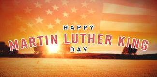 Composite image of happy martin luther king day. Happy Martin Luther King day against panoramic view of american flag royalty free stock photo