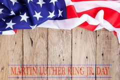 Happy martin luther king jr. day background with american flags. On old wood background stock photography