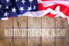 Happy martin luther king jr. day background with american flags. On old wood background royalty free stock photos