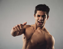 Happy masculine man showing thumbs up sign Stock Images