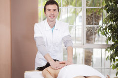 Happy masseuse loving his job Stock Photo