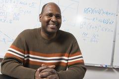 Happy Math Professor In Classroom Stock Photo