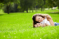 Happy mather. Mother and the small son lie on a summer lawn Stock Photography