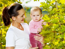 Happy mather with attractive baby outdoor Royalty Free Stock Photos