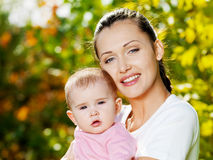 Happy mather with baby outdoor Royalty Free Stock Image