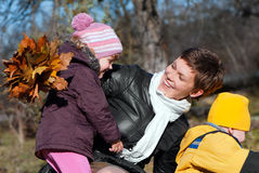 Happy mather and children in park Royalty Free Stock Image