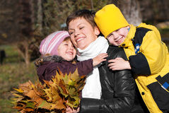 Happy mather and children in park Royalty Free Stock Photos