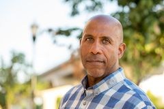 Happy mature African American man smiling outside. Stock Photos