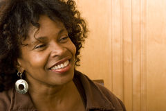 Happy mature African American woman smiling at home. Portrait of a happy African American woman smiling at home royalty free stock photos