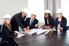 Happy mature architects in a meeting at the office Stock Photos