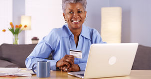 Happy Mature Black woman holding credit card stock photos