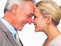 Happy mature business couple face to face Stock Images