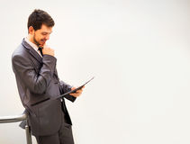Happy mature business man looking at camera with satisfaction Stock Photography
