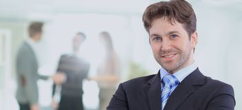 Happy mature business man looking at camera with satisfaction at office. Portrait of a mature business man Royalty Free Stock Photos
