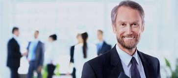 Happy mature business man looking at camera with satisfaction at office. Portrait of a mature business man Stock Images