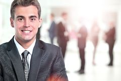 Happy mature business man looking at camera with satisfaction at office. Portrait of a mature business man Stock Photos