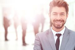 Happy mature business man looking at camera with satisfaction at office. Portrait of a mature business man Royalty Free Stock Photography
