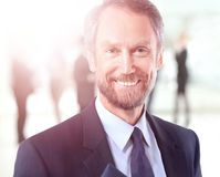 Happy mature business man looking at camera with satisfaction at office. Portrait of a mature business man Stock Photo