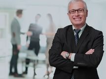 Happy mature business man looking at camera with satisfaction at office. Portrait of a mature business man Stock Photography