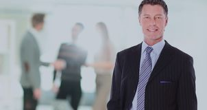 Happy mature business man looking at camera with satisfaction at office. Portrait of a mature business man Stock Image