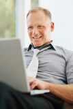 Happy mature business man using a laptop Royalty Free Stock Image