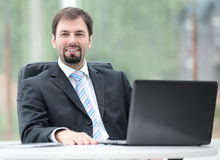 Happy mature business man work in modern office on computer Stock Photography