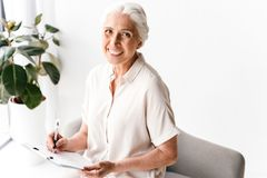 Happy mature business woman royalty free stock photos